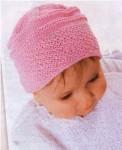 Розовая вязаная детская шапка