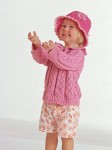 Розовый пуловер с рюшами